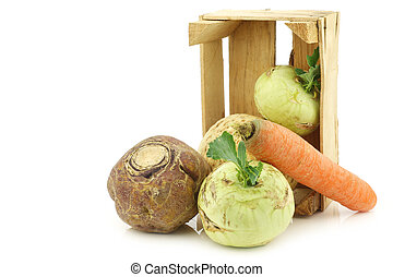 mixed cabbage and root vegetables in a wooden crate
