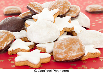 Mixed christmas cookies on red background with golden stars