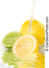 Mixed citrus - Water splashing on refreshing lemons and...