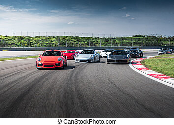 Mixed color sport cars drive on the road