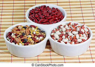 Mixed colorful beans in a white bowl