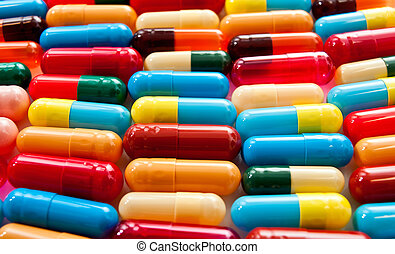 Mixed colorful capsules - A background of various colorful...