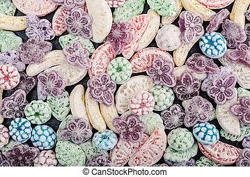 Mixed colorful fruit bonbon close up, may use as background