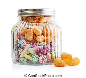 Mixed colorful fruit bonbon in transparent jar isolated on...