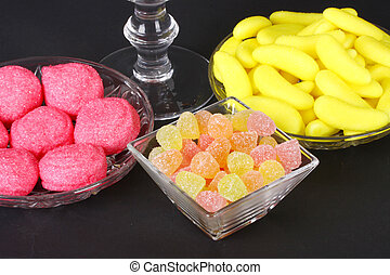 Mixed colorful jelly candies on black background