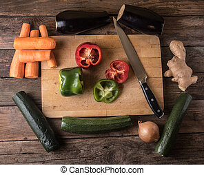 MIxed colorful vegetables on board, from overhead flat lay