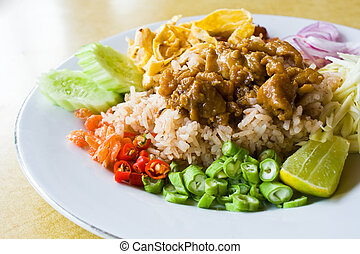 Mixed cooked rice with shrimp paste sauce on table