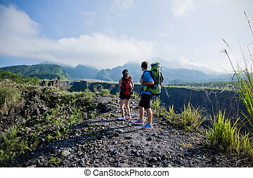 Mixed couple go trekking together, nature background - A...
