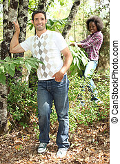 mixed couple rambling through nature