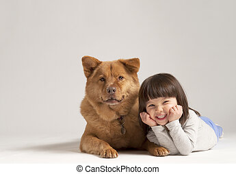 Mixed dog with cheerful child