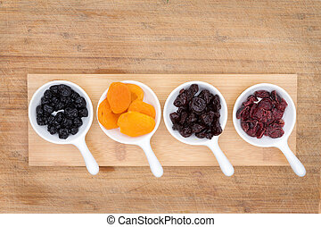 Mixed dried fruit and berries in ceramic ramekins