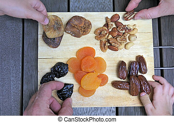 Mixed Dried Fruit - Mixed dried fruit on a wooden board...