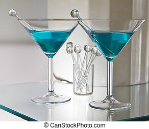 Dry mixed drinks on glass table with stir sticks