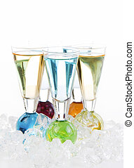 Vertical photo of mixed drinks surround by crushed ice on white background