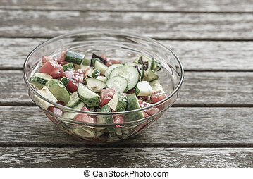 fresh salad on a wooden table