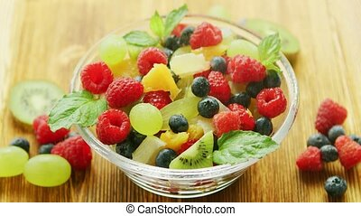 Mixed fruit salad - From above glass bowl full of mixed...