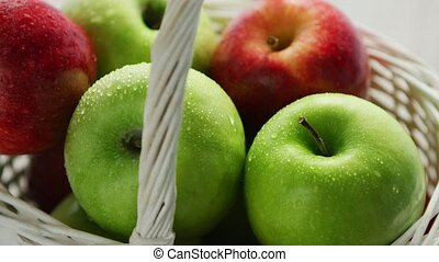 Mixed green and red apples in basket - From above shot of...