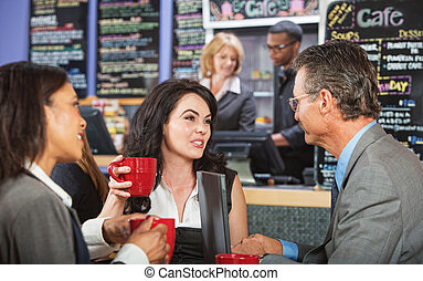 Mixed Group Talking in Cafe