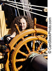 Mixed Heritage Woman Standing At Steering Wheel Tall Ship
