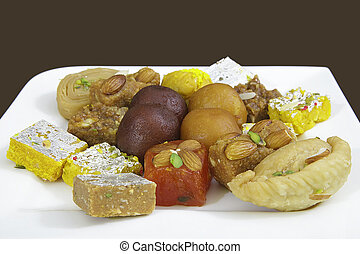 Mixed Indian Sweets on White Plate