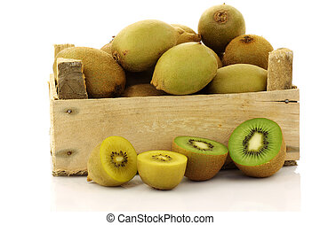 mixed kiwi fruit in a wooden crate