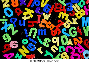 Mixed Letters and Numbers Scattered on a Magnet Board