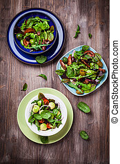 Mixed low calorie salads with olives and fresh avocado