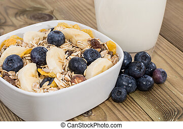 Mixed Muesli with Nuts and Fruits on wooden background