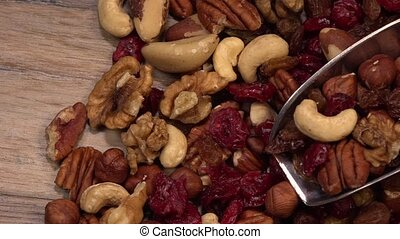 Mixed nuts and dried fruits in wooden bowl on wood background, Healthy snack, mix of organic nuts and dry fruits