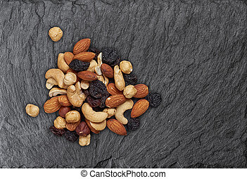 mixed nuts on a slate board. Top view