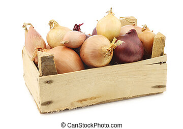 mixed onions in a wooden box