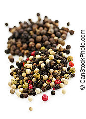 Mixed peppercorns - Mixed assorted peppercorns on white...