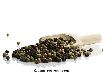 mixed peppercorns with a wooden shovel on white background