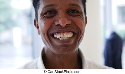Mixed Race Adult smiling in camera