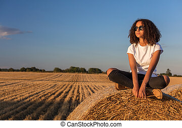 Mixed Race African American Girl Teen Sunglasses Sitting on Hay Bale
