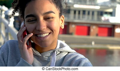 Mixed race African American girl teenager young woman on a...