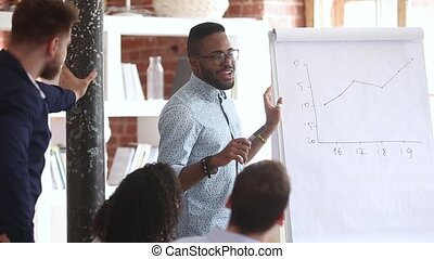 Mixed race business coach teach company staff during...