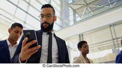 Mixed-race businessman standing in queue at business seminar...