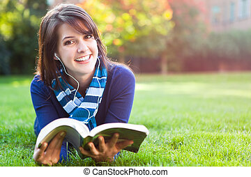 Mixed race college student studying - A portrait of a mixed...