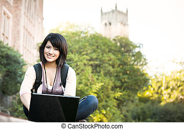 Mixed race college student with laptop