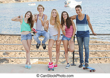 mixed race confident teens on student vacation