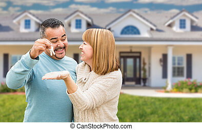 Mixed Race Couple in Front of House with Keys