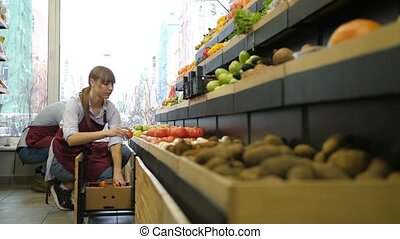Mixed race couple owners working at grocery store - Busy...