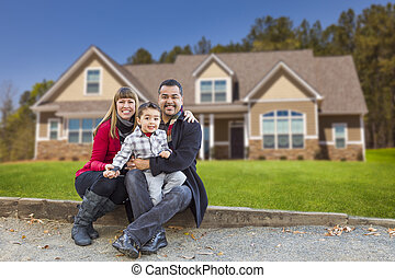 Mixed Race Family in Front of Their New Home