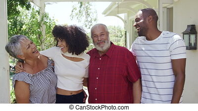 Mixed race family spending time together - Front view of a ...