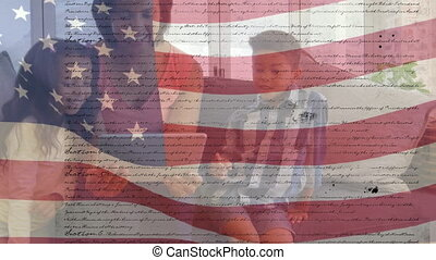 Animation of U.S. flag waving with U.S. Constitution text rolling over mixed race woman using a tablet with her children. United States of America flag and holiday concept digital composition