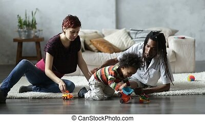 Mixed race family with child spending leisure