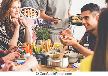 Mixed-race friends enjoying vegetarian lunch