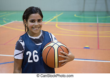 Mixed race girl holding basketball