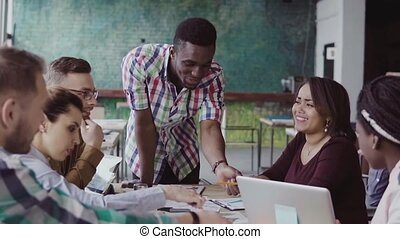 Mixed race group of architects on business meeting in modern...